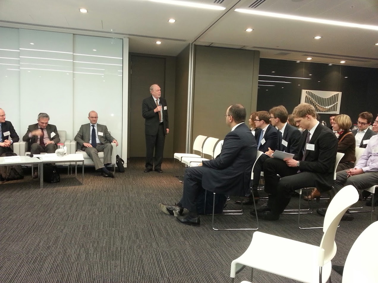 Managing Partner of Bryan Cave London office Rod Page greets the audience.
